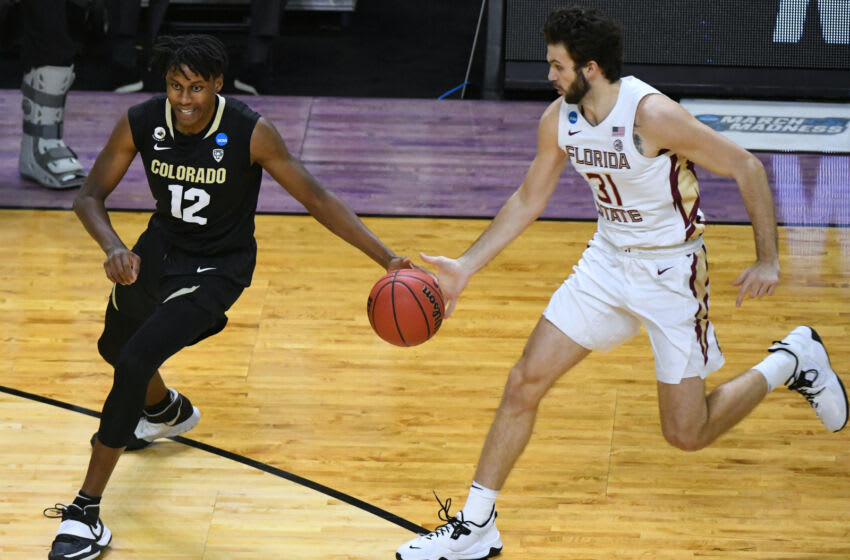 Mar 22, 2021; Indianapolis, Indiana, USA; Florida State Seminoles guard Wyatt Wilkes (31) attempts to steal the ball away from Colorado Buffaloes forward Jabari Walker (12) in the first half in the second round of the 2021 NCAA Tournament at Indiana Farmers Coliseum. Mandatory Credit: Robert Goddin-USA TODAY Sports