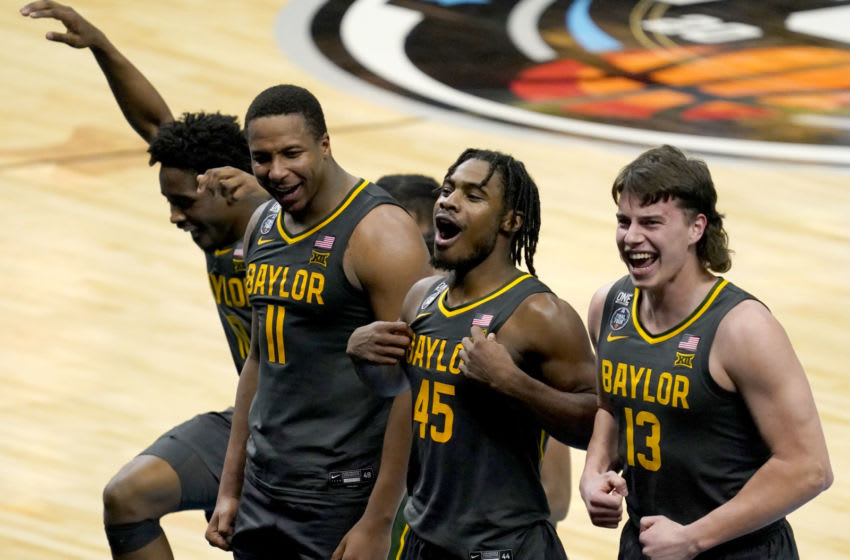 Baylor players including Baylor Bears guard Mark Vital (11), Baylor Bears guard Davion Mitchell (45) and Baylor Bears guard Jackson Moffatt (13) celebrate after defeating Gonzaga during the championship game of the 2021 NCAA Tournament on Monday, April 5, 2021, at Lucas Oil Stadium in Indianapolis, Ind. Mandatory Credit: Grace Hollars/IndyStar via USA TODAY Sports