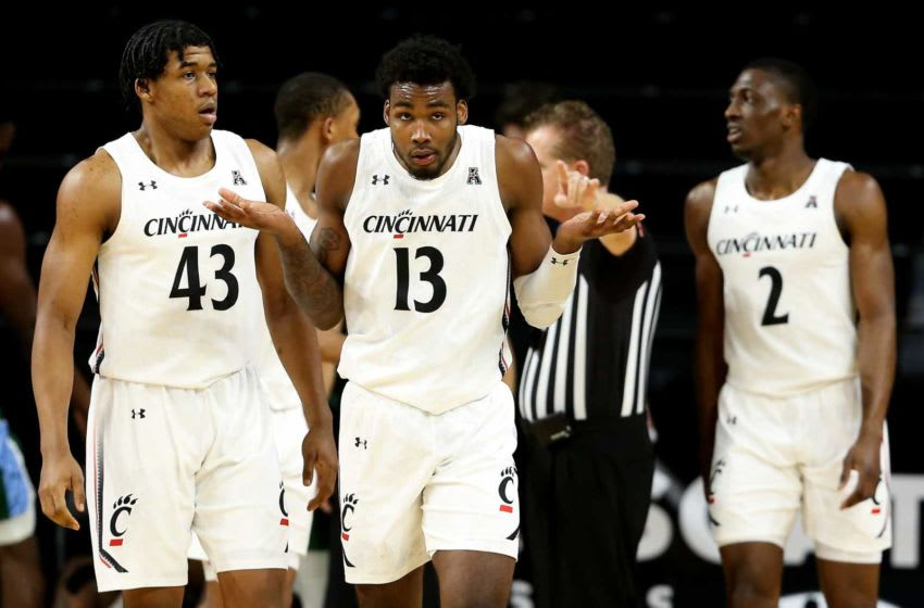 Cincinnati Bearcats forward Tari Eason (13) reacts toward the Cincinnati bench after being called for a foul on a blocked shot attempt in the second half of a men's NCAA basketball game against the Tulane Green Wave, Friday, Feb. 26, 2021, at Fifth Third Arena in Cincinnati. The Cincinnati Bearcats won, 91-71. Tulane Green Wave At Cincinnati Bearcats Feb 26