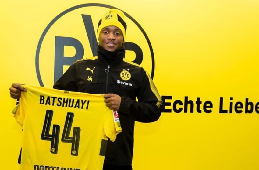 Michy Batshuayi holds a Borussia Dortmund shirt after signing for the club