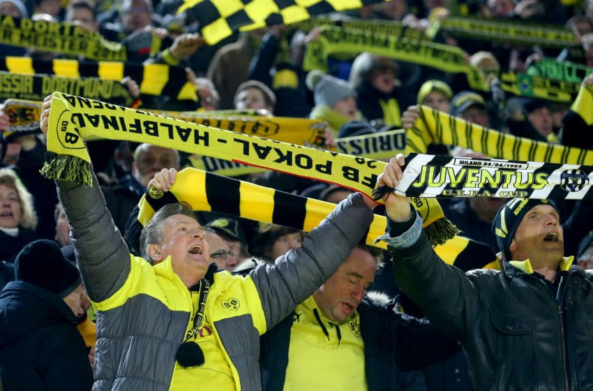 DORTMUND, GERMANY - MARCH 05: Fans of Dortmund celebrate during the Bundesliga match between Borussia Dortmund and FC Bayern Muenchen at Signal Iduna Park on March 5, 2016 in Dortmund, Germany. (Photo by Christof Koepsel/Getty Images For MAN)