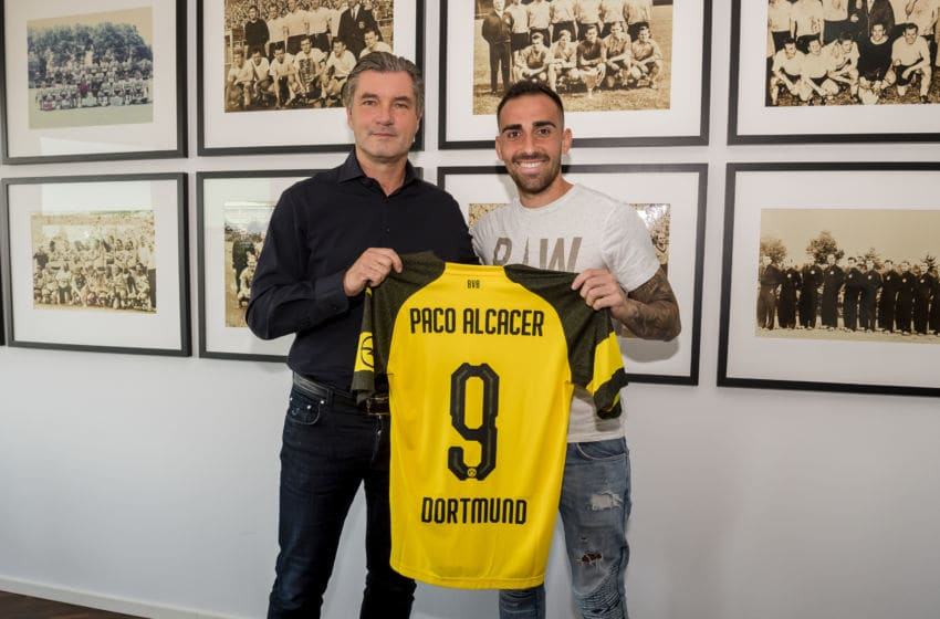 DORTMUND, GERMANY - AUGUST 28: Paco Alcacer signs a new contract with Borussia Dortmund with Michael Zorc (sports director of Borussia Dortmund) at Dortmund on August 28, 2018 in Dortmund, Germany. (Photo by Alexandre Simoes/Borussia Dortmund/Getty Images)