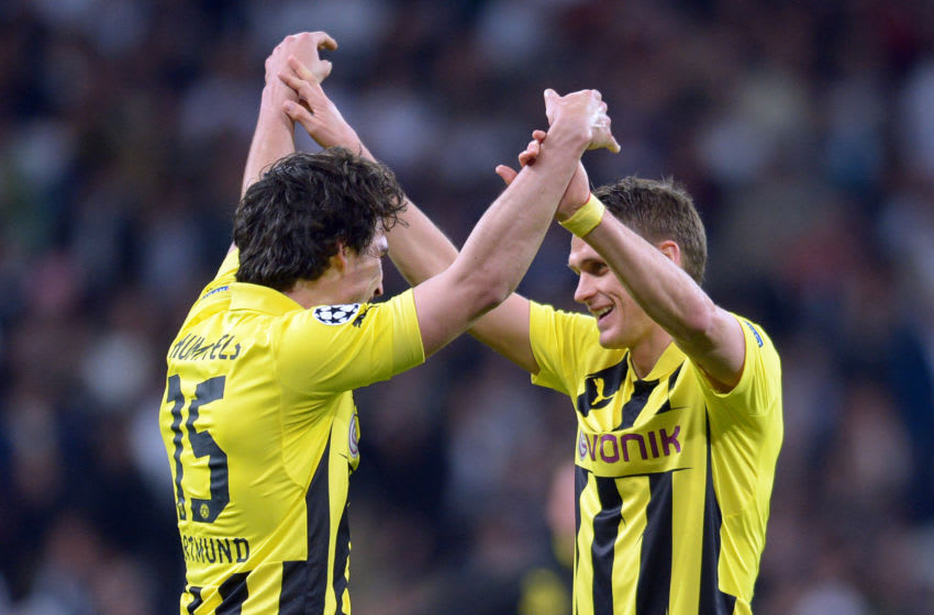 Dortmund's Mats Hummels (L) celebrates with Sebastian Kehl at the end of the UEFA Champions League semi final second leg soccer match between Borussia Dortmund and Real Madrid at Santiago Bernabeu stadium, Spain, 30 April 2013. Photo: Federico Gambarini/dpa +++(c) dpa - Bildfunk+++ | usage worldwide (Photo by Federico Gambarini/picture alliance via Getty Images)