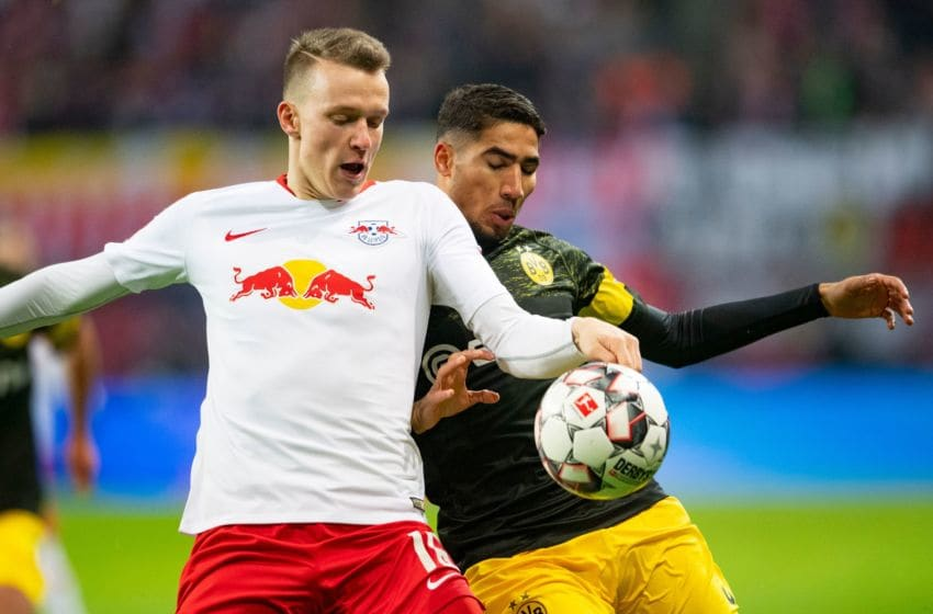 Leipzig's defender Lukas Klostermann (L) vies with Dortmund's Moroccan defender Achraf Hakimi during the German first division Bundesliga football match RB Leipzig v Borussia Dortmund in Leipzig, eastern Germany, on January 19, 2019. (Photo by ROBERT MICHAEL / AFP) / DFL REGULATIONS PROHIBIT ANY USE OF PHOTOGRAPHS AS IMAGE SEQUENCES AND/OR QUASI-VIDEO (Photo credit should read ROBERT MICHAEL/AFP/Getty Images)