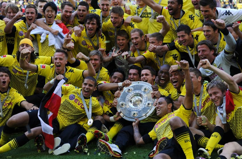 DORTMUND, GERMANY - MAY 14: Players of Dortmund celebrate with the trophy after the Bundesliga match between Borussia Dortmund and Eintracht Frankfurt at Signal Iduna Park on May 14, 2011 in Dortmund, Germany. (Photo by Lars Baron/Bongarts/Getty Images)