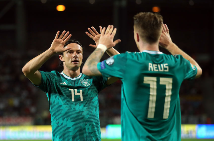 BARYSAW, BELARUS - JUNE 08: Nico Schulz of Germany congratulates team-mate Marco Reus during the UEFA Euro 2020 qualifier match between Belarus and Germany at Borisov-Arena on June 08, 2019 in Barysaw, Belarus. (Photo by Alexander Hassenstein/Bongarts/Getty Images)