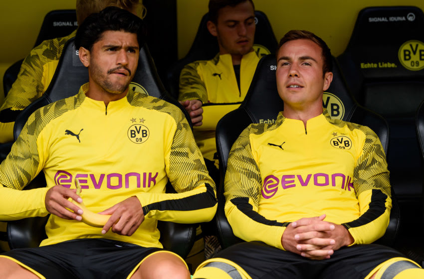 DORTMUND, GERMANY - AUGUST 17: Mahmoud Dahoud of Borussia Dortmund and Mario Goetze of Borussia Dortmund sit on the bench looks on prior to the Bundesliga match between Borussia Dortmund and FC Augsburg at Signal Iduna Park on August 17, 2019 in Dortmund, Germany. (Photo by TF-Images/ Getty Images)