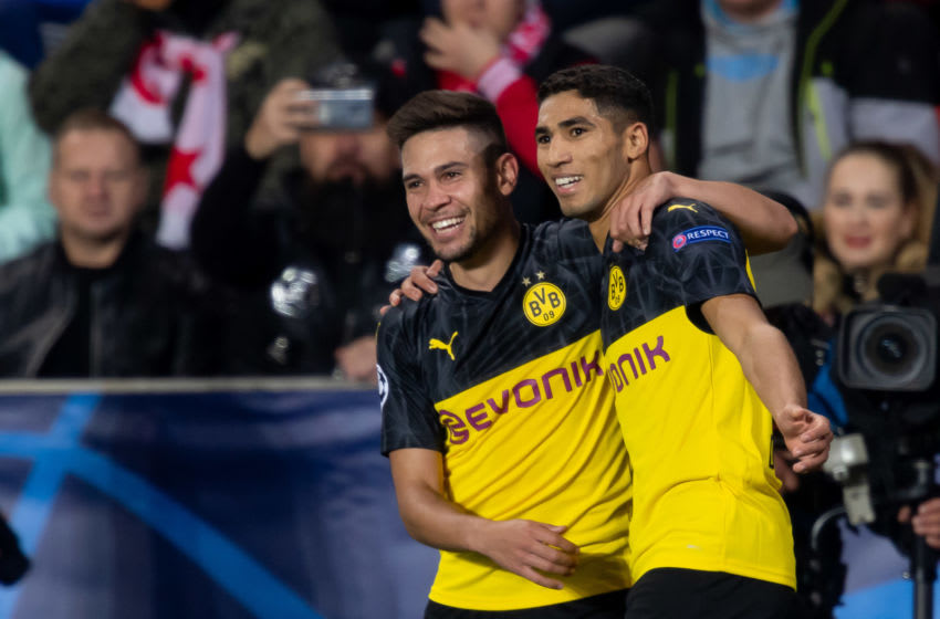 Achraf Hakimi and Raphael Guerreiro of Borussia Dortmund (Photo by TF-Images/Getty Images)