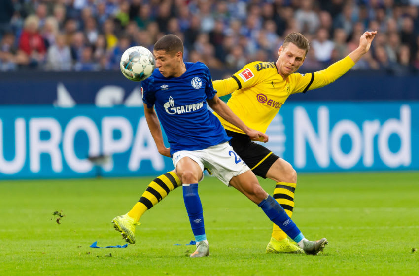 GELSENKIRCHEN, GERMANY - OCTOBER 26: Amine Harit of FC Schalke 04 and Lukasz Piszczek of Borussia Dortmund battle for the ball during the Bundesliga match between FC Schalke 04 and Borussia Dortmund at Veltins-Arena on October 26, 2019 in Gelsenkirchen, Germany. (Photo by TF-Images/Getty Images)