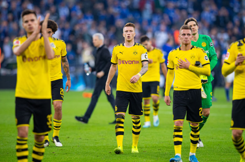 26 October 2019, North Rhine-Westphalia, Gelsenkirchen: Soccer: Bundesliga, FC Schalke 04 - Borussia Dortmund, 9th matchday in the Veltins Arena. Dortmund's Marco Reus (m) goes with his team-mates towards the fans after the match. Photo: Guido Kirchner/dpa (Photo by Guido Kirchner/picture alliance via Getty Images)