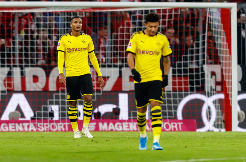 MUNICH, GERMANY - NOVEMBER 09: Manuel Akanji of Borussia Dortmund, Jadon Sancho of Borussia Dortmund looks dejected during the Bundesliga match between FC Bayern Muenchen and Borussia Dortmund at Allianz Arena on November 9, 2019 in Munich, Germany. (Photo by TF-Images/Getty Images)
