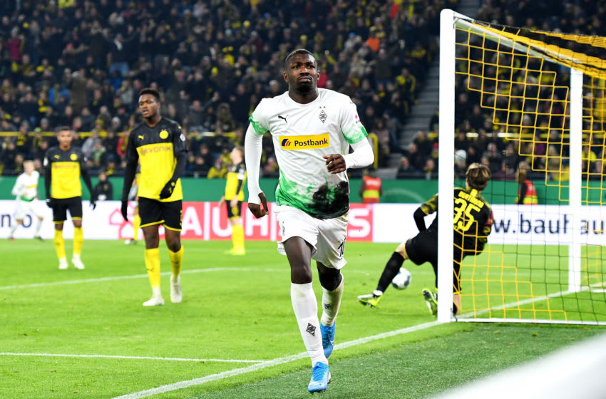 DORTMUND, GERMANY - OCTOBER 30: Marcus Thuram of Borussia Monchengladbach celebrates after scoring his team's first goal during the DFB Cup second round match between Borussia Dortmund and Borussia Moenchengladbach at Signal Iduna Park on October 30, 2019 in Dortmund, Germany. (Photo by Jörg Schüler/Bongarts/Getty Images)