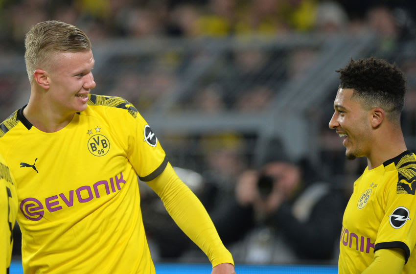 DORTMUND, GERMANY - JANUARY 24: (BILD ZEITUNG OUT) Erling Braut Haaland of Borussia Dortmund and Jadon Sancho of Borussia Dortmund laughs during the Bundesliga match between Borussia Dortmund and 1. FC Koeln at Signal Iduna Park on January 24, 2020 in Dortmund, Germany. (Photo by TF-Images/Getty Images)