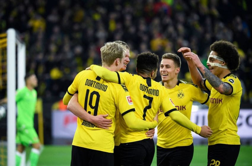 (L-R) Dortmund's German forward Julian Brandt, English forward Jadon Sancho, Belgian forward Thorgan Hazard and Belgian midfielder Axel Witsel congratulate forward Erling Braut Haaland (hidden) after scoring during the German first division Bundesliga football match Borussia Dortmund vs FC Union Berlin in Dortmund on February 1, 2020. (Photo by INA FASSBENDER / AFP) / RESTRICTIONS: DFL REGULATIONS PROHIBIT ANY USE OF PHOTOGRAPHS AS IMAGE SEQUENCES AND/OR QUASI-VIDEO (Photo by INA FASSBENDER/AFP via Getty Images)