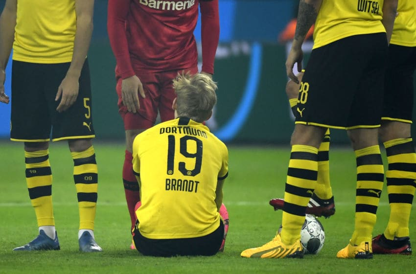 Dortmund's German forward Julian Brandt sits on the field after injury during the German first division Bundesliga football match Bayer 04 Leverkusen vs BVB Borussia Dortmund in Leverkusen, western Germany on February 8, 2020. (Photo by INA FASSBENDER / AFP) / RESTRICTIONS: DFL REGULATIONS PROHIBIT ANY USE OF PHOTOGRAPHS AS IMAGE SEQUENCES AND/OR QUASI-VIDEO (Photo by INA FASSBENDER/AFP via Getty Images)