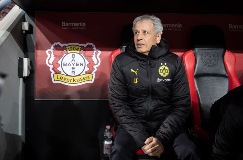 08 February 2020, North Rhine-Westphalia, Leverkusen: Football: Bundesliga, Bayer Leverkusen - Borussia Dortmund, 21st matchday in the BayArena: Coach Lucien Favre of Dortmund takes a seat on the bench. Photo: Bernd Thissen/dpa - IMPORTANT NOTE: In accordance with the regulations of the DFL Deutsche Fußball Liga and the DFB Deutscher Fußball-Bund, it is prohibited to exploit or have exploited in the stadium and/or from the game taken photographs in the form of sequence images and/or video-like photo series. (Photo by Bernd Thissen/picture alliance via Getty Images)