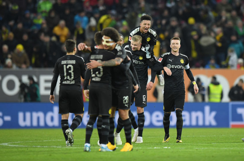 AUGSBURG, GERMANY - JANUARY 18: Players of Borussia Dortmund celebrate after their team's fourth goal during the Bundesliga match between FC Augsburg and Borussia Dortmund at WWK-Arena on January 18, 2020 in Augsburg, Germany. (Photo by Sebastian Widmann/Bongarts/Getty Images)