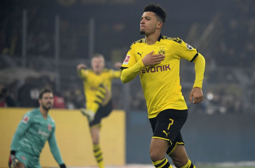 Dortmund's English midfielder Jadon Sancho celebrate scoring during the German first division Bundesliga football match BVB Borussia Dortmund vs Eintracht Frankfurt, in Dortmund, western Germany on February 14, 2020. (Photo by INA FASSBENDER / AFP) / RESTRICTIONS: DFL REGULATIONS PROHIBIT ANY USE OF PHOTOGRAPHS AS IMAGE SEQUENCES AND/OR QUASI-VIDEO (Photo by INA FASSBENDER/AFP via Getty Images)
