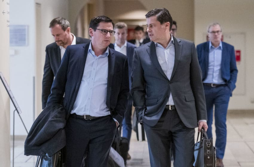 FRANKFURT AM MAIN, GERMANY - MARCH 16: Oliver Leki (SC Freiburg, L) and CEO of DFL Christian Seifert (R) arrive for the general assembly of the German Football League (DFL) on March 16, 2020 in Frankfurt am Main, Germany. Members of the executive committee of the DFL and clubs of the Bundesliga and Second Bundesliga meet to discuss the postponement of all matches until April 2, 2020 and it's consequences due to the ongoing spread of Covid-19 (Coronavirus). (Photo by Thomas Lohnes/Getty Images)