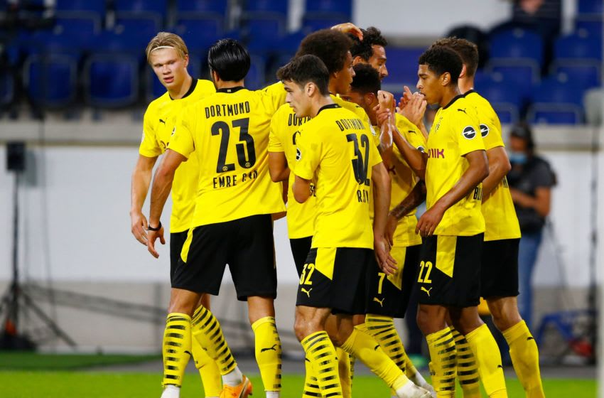 Borussia Dortmund players celebrate a goal (Photo by THILO SCHMUELGEN/POOL/AFP via Getty Images)