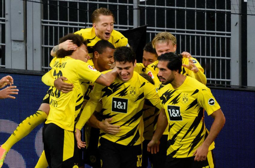 Emre Can of Borussia Dortmund celebrates with his teammates. (Photo by Alex Gottschalk/DeFodi Images via Getty Images)