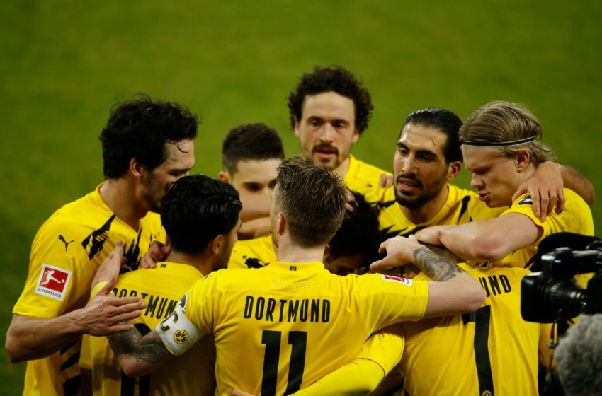 Borussia Dortmund celebrated a famous win over rivals Schalke (Photo by LEON KUEGELER/POOL/AFP via Getty Images)