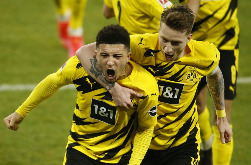 Jadon Sancho got a goal and an assist as Borussia Dortmund thrashed Schalke (Photo by LEON KUEGELER/POOL/AFP via Getty Images)