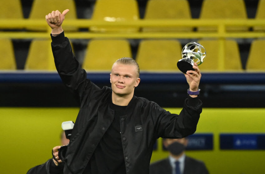 Erling Haaland celebrates on the pitch after receiving the Forward of the Year award (Photo by INA FASSBENDER/AFP via Getty Images)