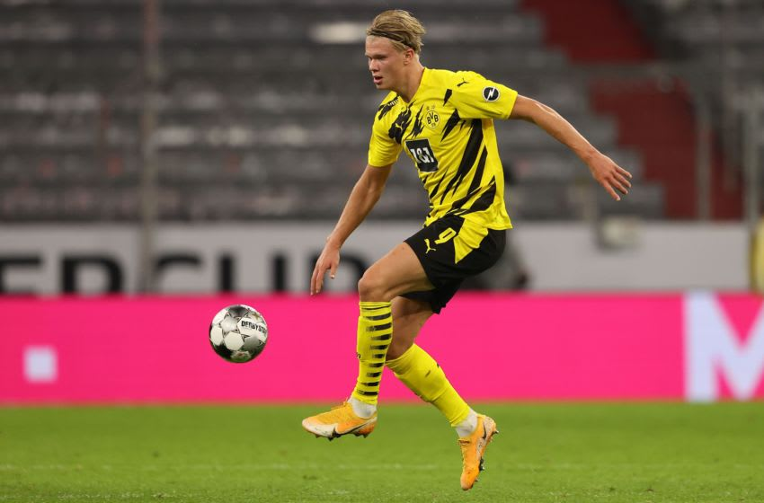 MUNICH, GERMANY - SEPTEMBER 30: Erling Haaland of Dortmund runs with the ball during the Supercup 2020 match between FC Bayern München and Borussia Dortmund at Allianz Arena on September 30, 2020 in Munich, Germany. (Photo by Alexander Hassenstein/Getty Images )