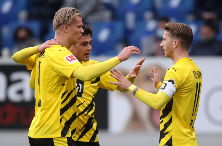 SINSHEIM, GERMANY - OCTOBER 17: Marco Reus of Borussia Dortmund celebrates with teammates Erling Haaland and Giovanni Reyna after scoring his sides first goal during the Bundesliga match between TSG Hoffenheim and Borussia Dortmund at PreZero-Arena on October 17, 2020 in Sinsheim, Germany. A limited number of fans (6030) have been allowed into the stadium as COVID-19 precautions ease in Germany. (Photo by Alex Grimm/Getty Images)