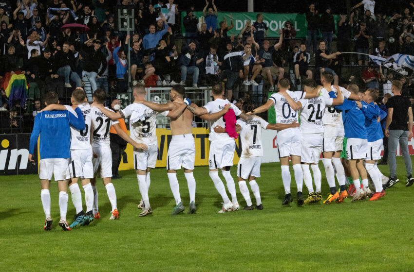 SV Babelsberg 03 players celebrate their Pokal win with their fans. (Photo by Christian Ender/Getty Images)