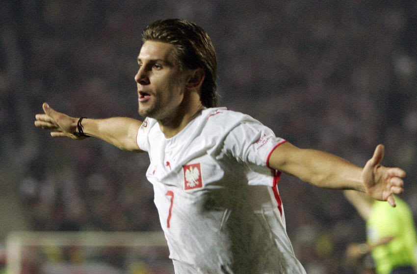 Chorzow, POLAND: Euzebiusz Smolarek of Poland celebrates after scoring the second goal during their Euro 2008 qualifying football match against Portugal in Chorzow 11 October 2006. AFP PHOTO / JANEK SKARZYNSKI (Photo credit should read JANEK SKARZYNSKI/AFP via Getty Images)