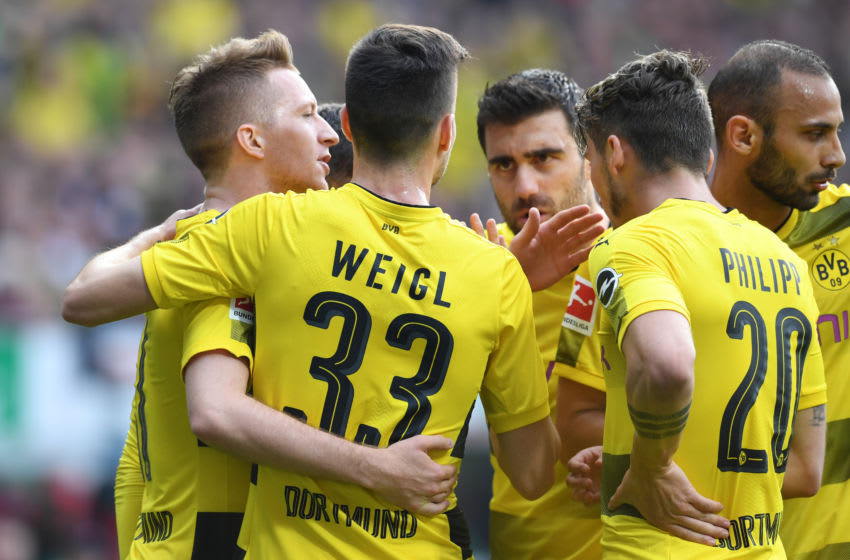 BREMEN, GERMANY - APRIL 29: Marco Reus (1st L) of Borussia Dortmund celebrates scoring his side's first goal with his team mates during the Bundesliga match between SV Werder Bremen and Borussia Dortmund at Weserstadion on April 29, 2018 in Bremen, Germany. (Photo by Etsuo Hara/Getty Images)