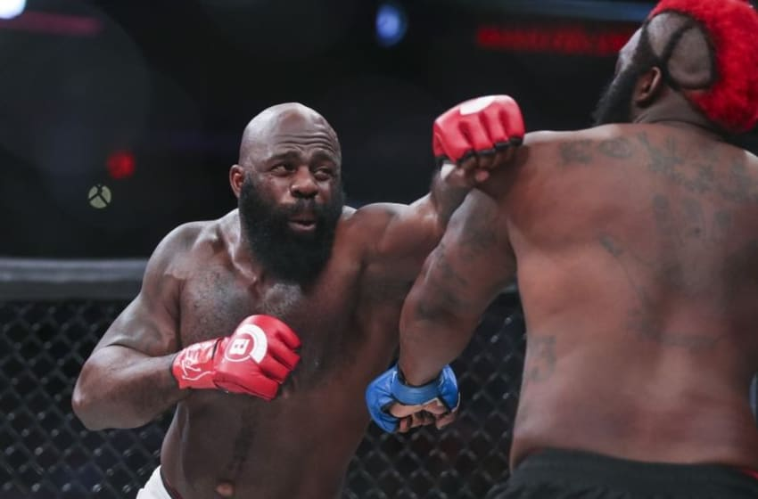 Feb 19, 2016; Houston, TX, USA; Kimbo Slice (red gloves) competes against Dada 5000 (blue gloves) during their Heavyweight fight at Bellator 149 at Toyota Center. Mandatory Credit: Troy Taormina-USA TODAY Sports