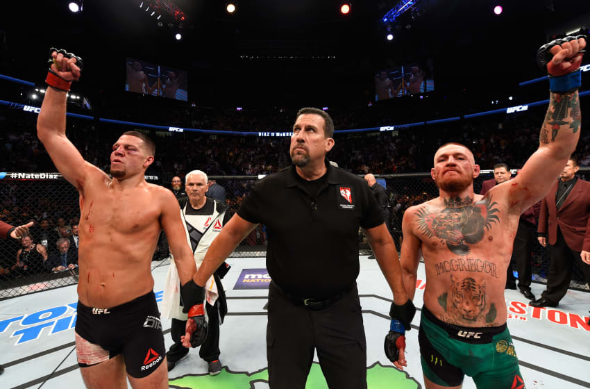 LAS VEGAS, NV - AUGUST 20: (R-L) Conor McGregor of Ireland and Nate Diaz raise their hands and wait to hear the judges decision after their welterweight bout during the UFC 202 event at T-Mobile Arena on August 20, 2016 in Las Vegas, Nevada. (Photo by Josh Hedges/Zuffa LLC/Zuffa LLC via Getty Images)