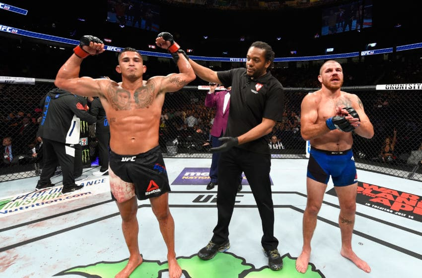 LAS VEGAS, NV - JULY 08: (L-R) Anthony Pettis celebrates his victory over Jim Miller in their lightweight bout during the UFC 213 event at T-Mobile Arena on July 8, 2017 in Las Vegas, Nevada. (Photo by Josh Hedges/Zuffa LLC/Zuffa LLC via Getty Images)