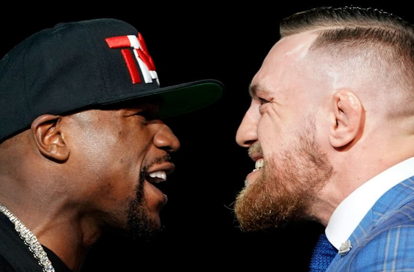 TORONTO, CANADA - JULY 12: (L-R) Floyd Mayweather Jr. and Conor McGregor face off during the Floyd Mayweather Jr. v Conor McGregor World Press Tour event at the Budweiser Stage on July 12, 2017 in Toronto, Ontario, Canada. (Photo by Jeff Bottari/Zuffa LLC/Zuffa LLC via Getty Images)