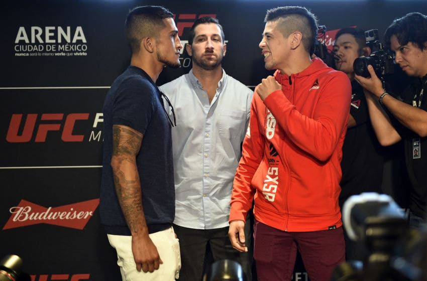 MEXICO CITY, MEXICO - AUGUST 03: (L-R) Sergio Pettis and Brandon Moreno of Mexico face off for the media during the UFC Ultimate Media Day at the W Hotel on August 3, 2017 in Mexico City, Mexico. (Photo by Jeff Bottari/Zuffa LLC/Zuffa LLC via Getty Images)