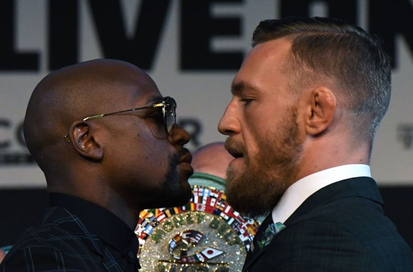 LAS VEGAS, NV - AUGUST 23: Boxer Floyd Mayweather Jr. (L) and UFC lightweight champion Conor McGregor face off during a news conference at the KA Theatre at MGM Grand Hotel