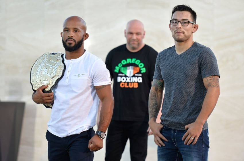 LAS VEGAS, NV - AUGUST 24: (L-R) UFC flyweight champion Demetrious Johnson and Ray Borg pose during the UFC 215