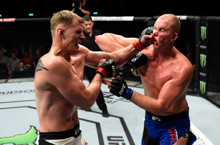 ROTTERDAM, NETHERLANDS - SEPTEMBER 02: (L-R) Alexander Volkov of Russia punches Stefan Struve of The Netherlands in their heavyweight bout during the UFC Fight Night event at the Rotterdam Ahoy on September 2, 2017 in Rotterdam, Netherlands. (Photo by Josh Hedges/Zuffa LLC/Zuffa LLC via Getty Images)