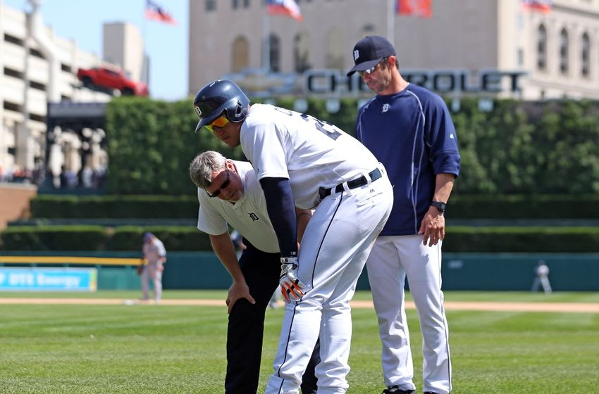 May 22, 2016; Detroit, MI, USA; Detroit Tigers head trainer Kevin Rand and manager Brad Ausmus check on first baseman Miguel Cabrera (24) after getting hit with the pitch during the seventh inning of the game against the Tampa Bay Rays at Comerica Park. Mandatory Credit: Leon Halip-USA TODAY Sports