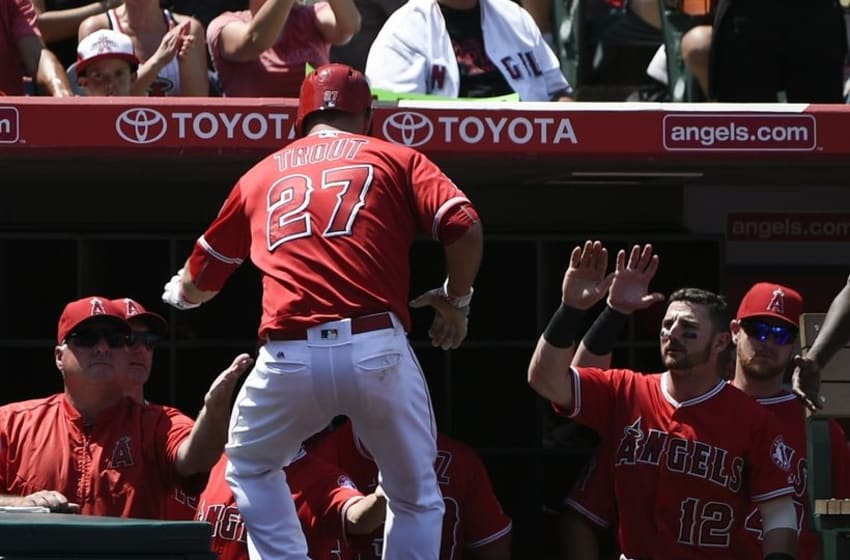 Jul 31, 2016; Anaheim, CA, USA; Los Angeles Angels center fielder Mike Trout (27) celebrates with his team after he scores against the Boston Red Sox during the fifth inning at Angel Stadium of Anaheim. Mandatory Credit: Kelvin Kuo-USA TODAY Sports