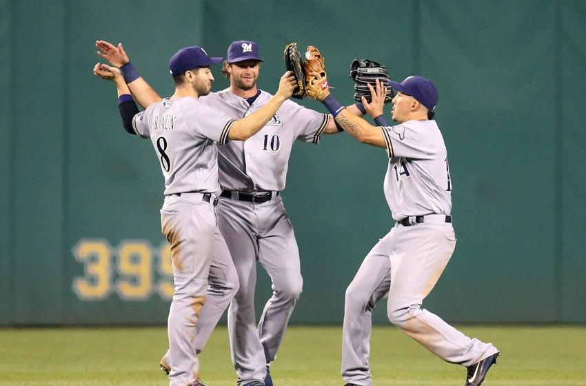 Jul 20, 2016; Pittsburgh, PA, USA; Milwaukee Brewers left fielder Ryan Braun (8) and center fielder Kirk Nieuwenhuis (10) and right fielder Hernan Perez (14) celebrate after defeating the Pittsburgh Pirates at PNC Park. Milwaukee won 9-5. Mandatory Credit: Charles LeClaire-USA TODAY Sports