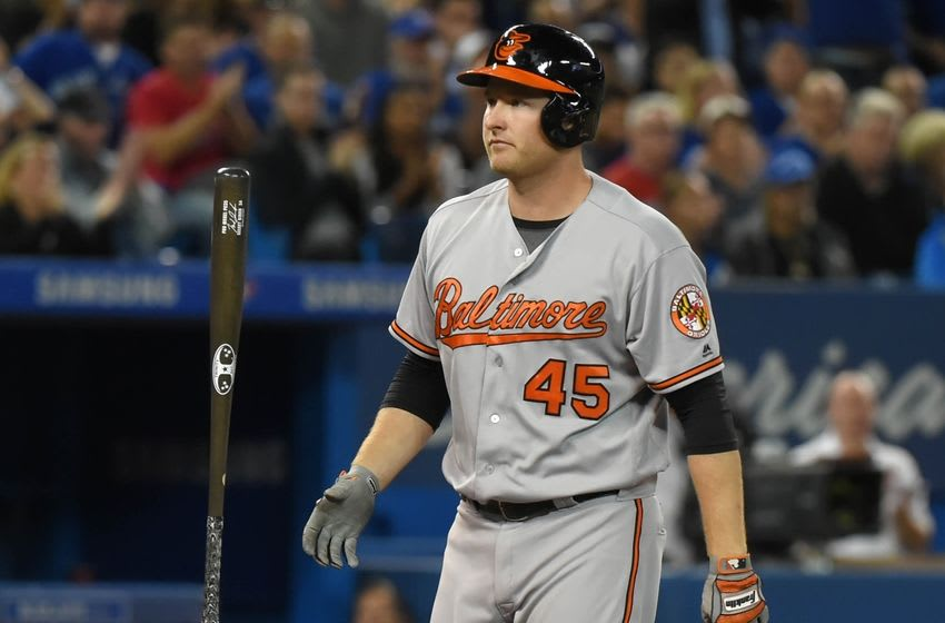 Sep 28, 2016; Toronto, Ontario, CAN; Baltimore Orioles right fielder Mark Trumbo (45) reacts after striking out with two men on in the fourth inning against Toronto Blue Jays at Rogers Centre. Mandatory Credit: Dan Hamilton-USA TODAY Sports