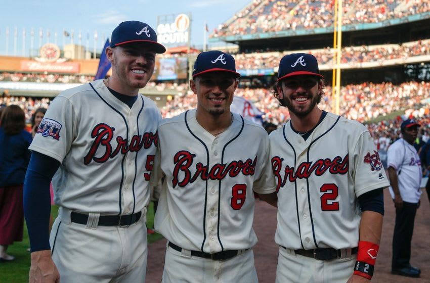 Oct 2, 2016; Atlanta, GA, USA; Atlanta Braves first baseman Freddie Freeman (5) and second baseman Jace Peterson (8) and shortstop Dansby Swanson (2) pose for a photo after a game against the Detroit Tigers at Turner Field. The Braves defeated the Tigers 1-0. Mandatory Credit: Brett Davis-USA TODAY Sports