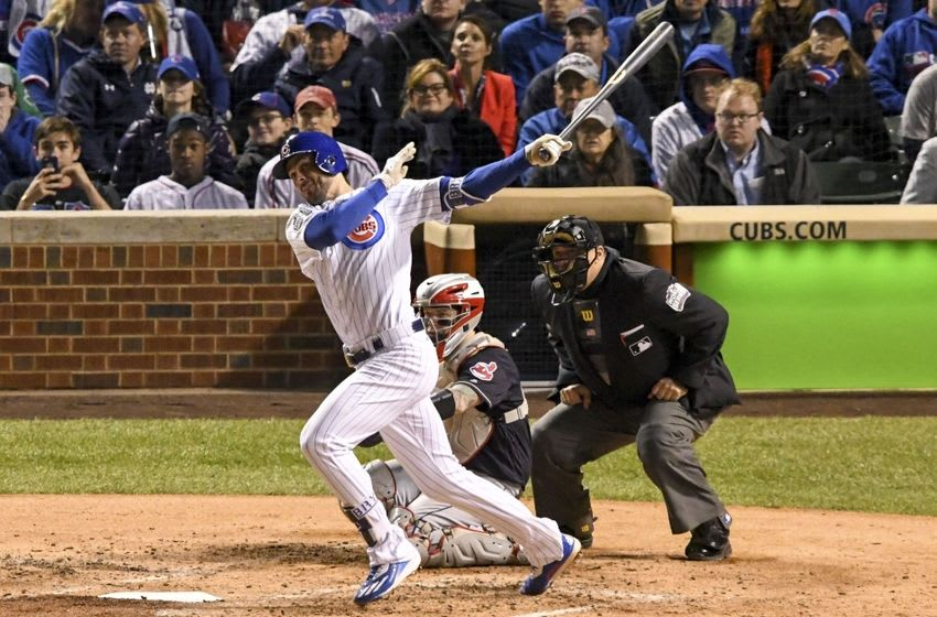 Oct 30, 2016; Chicago, IL, USA; Chicago Cubs third baseman Kris Bryant (left) hits a solo home run against Cleveland Indians catcher Roberto Perez (center) during the fourth inning in game five of the 2016 World Series at Wrigley Field. Mandatory Credit: Tommy Gilligan-USA TODAY Sports