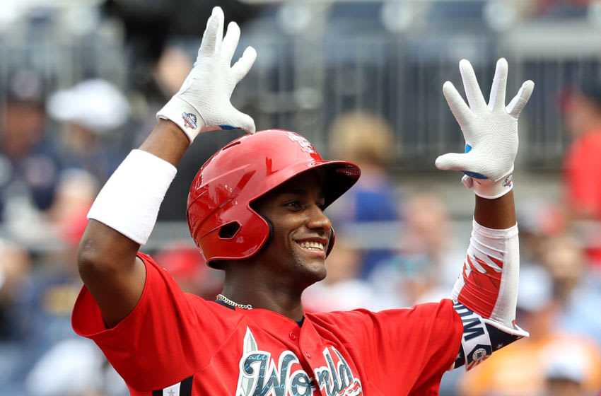 WASHINGTON, D.C. - JULY 15: Seuly Matias #25 of the World Team reacts after hitting a home run during the SiriusXM All-Star Futures Game at Nationals Park on July 15, 2018 in Washington, DC. (Photo by Rob Carr/Getty Images)