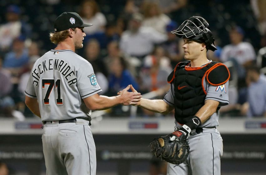 NEW YORK, NY - SEPTEMBER 11: Drew Steckenrider #71 and J.T. Realmuto #11 of the Miami Marlins celebrate after defeating the New York Mets at Citi Field on September 11, 2018 in the Flushing neighborhood of the Queens borough of New York City. (Photo by Jim McIsaac/Getty Images)