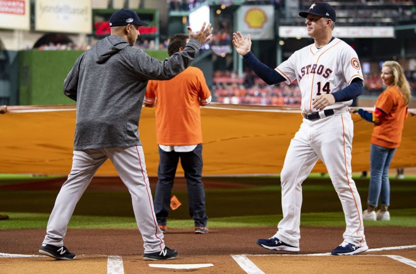 HOUSTON, TX - OCTOBER 16: Manager Alex Cora of the Boston Red Sox shakes hands with manager A.J. Hinch of the Houston Astros as lineups are introduced before game three of the American League Championship Series on October 16, 2018 at Minute Maid Park in Houston, Texas. (Photo by Billie Weiss/Boston Red Sox/Getty Images)